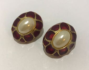 Red enamel clip earrings and faux pearls