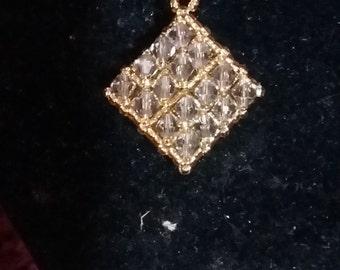 crystal diamond shaped pendant