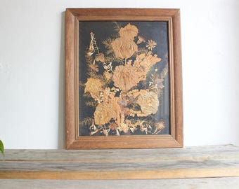 pressed flowers in wood frame