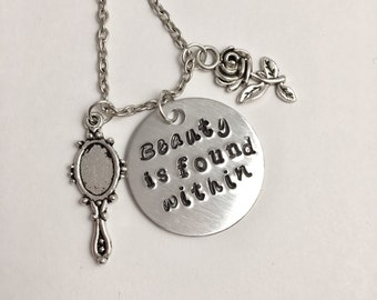 Beauty is found within hand stamped necklace with rose and mirror charms