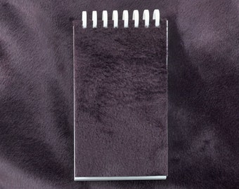 Plum Velboa covered refillable pocket journal/notebook; Cover has recycled content.
