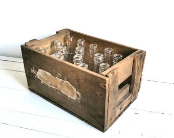 Strong wooden crate with old lemonade bottles