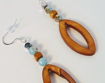 Brown and Natural Dangle Earrings With Blue Accents