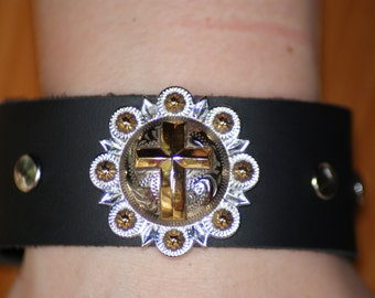 Women's leather bracelet with cross pendant.