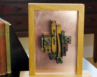 Framed antique wood letterpress type