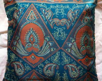 Mathura series 1: cushion 40x40cm (16 x 16) vintage green synthetic silk sari, orange cotton, Indian motifs.