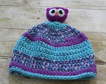 Crochet toddler hat with a litle animal