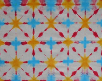 Ice-dyed cotton in Shibori style.  Primary colours.  For sewing and quilting.