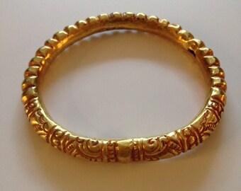 A GOLD RIGID BRACELET. Champa, Vietnam 14th Century