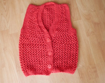 Red knitted sweater vest