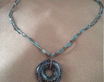 Blue and brown beaded necklace with pendant