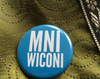 "1.25"" button ""MNI WICONI""  Water is Life in Lakota.  Blue."