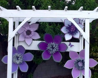 These fun  paper flowers in different purples are head turners.#paperflowers #weddings #birthdays #babyshowers