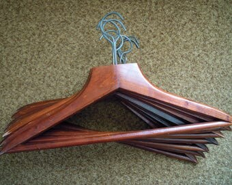 Wooden closet hangers. Lacquered. Hang clothes. Vintage 1980s. Set of 7 pieces.