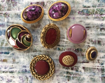 Eight shank buttons in gold and purple