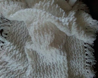 Soft and fluffy baby blanket with fringing.