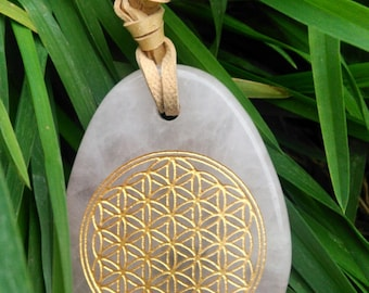 ACTION : Drop shape natural stone pendant with carved golden flower of life