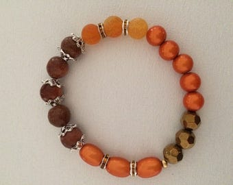 A row faceted Beads Bracelet gold, orange and Brown sequined agates.