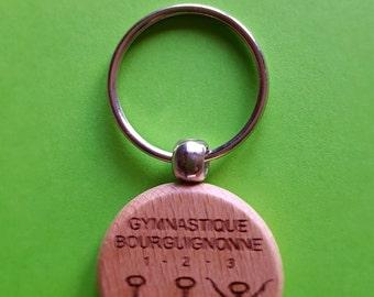 Keyring in wood Ø 40 mm pattern: Burgundian gymnastics