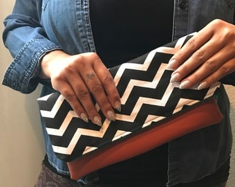 Chevron faux leather bottom foldover clutch