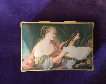 "Vintage music jewerly box  plays ""I'd like to teach the world to sing"""