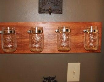 Reclaimed wood mason jar wall organizer