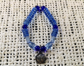 Blue glass bead bracelet with silver fish charm