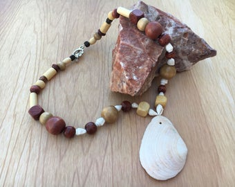 Wood beaded necklace with a white shell pendant