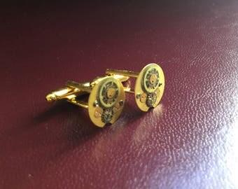 Steampunk golden cufflinks