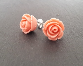 Flower Stud Earrings.  Silver plated posts with pretty pink flowers
