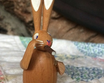 Wooden rabbit w cigar.