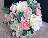 Brides silk wedding bouquet made with silk cream roses and pink foam roses