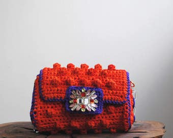 Orange bobble bag with purple accents