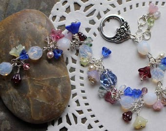 Bracelet with blue, white and pastel flower beads, Czech glass opaque white beads, Swarovski crystals and pearls, toggle, B022