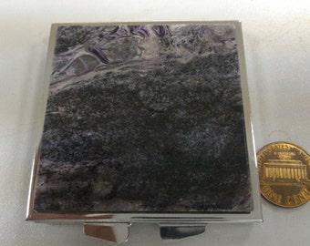 Pocket stone mirror
