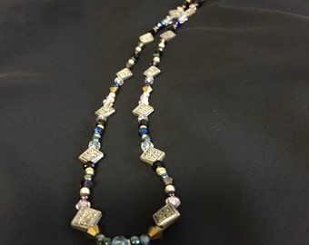 Silver beaded necklace with dragon fly
