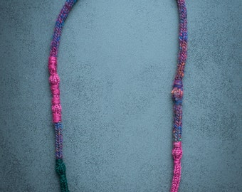 Upcycling chain made of wool in pink, green and purple patterned