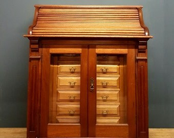 SORRY NOW SOLD Early 20th century roll top desk, collectors cabinet,harberdashry chest,mahogany.