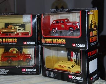 Eight mint Gorgi cars and trucks.