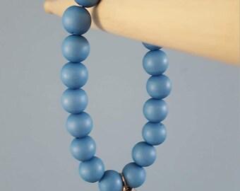 Blue bracelet with a bird
