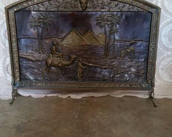 Brass fire screen embossed with pyramid picture.