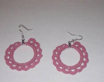 Handmade crochet hoop earrings in dusty rose.