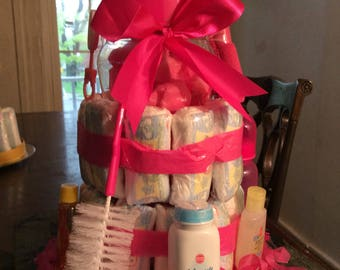 Hot pink diaper cake for a girl