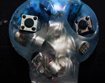 badge skull, glow in the dark, electronic recycling blue and silver