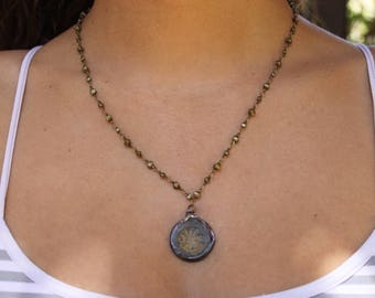 Dark Circular Beach Pendant on Bronze Chain