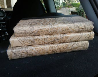 Old world map paper wrapped books