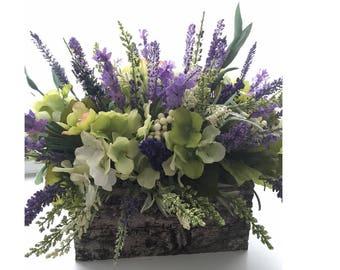 Purple Flower Arrangement in a Rustic Bark Container