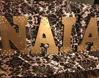 Gold with pearls letters