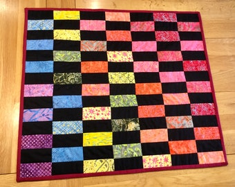 A vibrant cotton baby or lap quilt