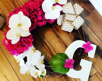 Stick wreath with floral accents